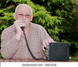 closeup image of senior making amateur radio 2way call