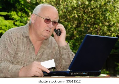 closeup image of senior online shopping using laptop and credit card, advert on white card or laptop
