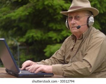 Close-up image of a senior using a laptop