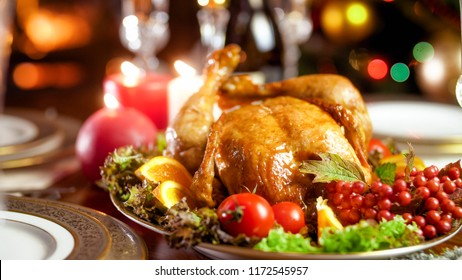 Closeup image of served dining table for family Christmas dinner at burning fireplace