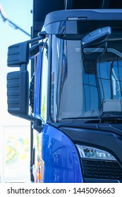 Close-up image of the side mirror and part of the truck body