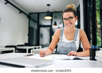 Close-up image of smiling student girl or young entrepreneur.
