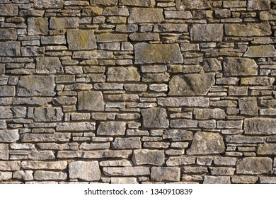 Close-up image of a stone wall