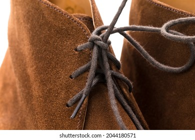 Closeup Image of Texture of Brown Suede Mens Shoes With Shoelaces Over White Background. Horizontal Orientation