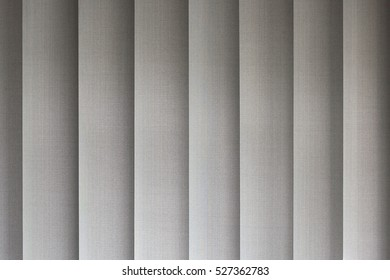 Closeup image of the texture of grey blinds from a window.