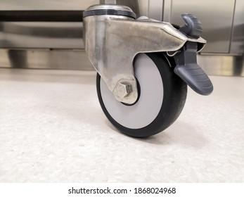 Closeup Image Of Trolley Wheel With Break. Selective Focus