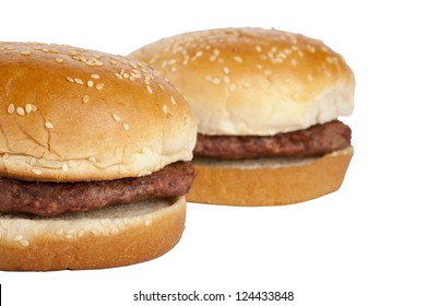 Close-up image of two unhealthy burger sandwiches over the white background