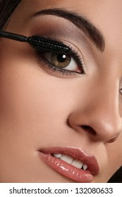 Closeup image of woman's eye with evening make up