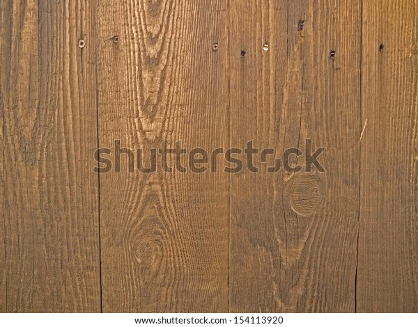 A close-up image of a wooden fence.