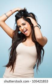 Closeup Indian cute teenage girl posing for camera blue background