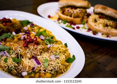 Closeup of Indian Dishes Ragda Patties with Dabeli in the Background for the Hindu Festival of Navratri