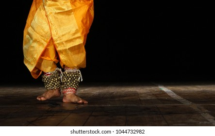 Closeup of Indian Kathak style male dancer with costume and bells tied to the legs, a tradition