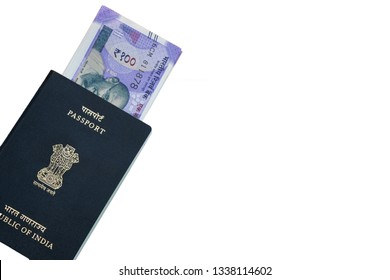 Closeup of Indian passport with Indian currency on isolated background.