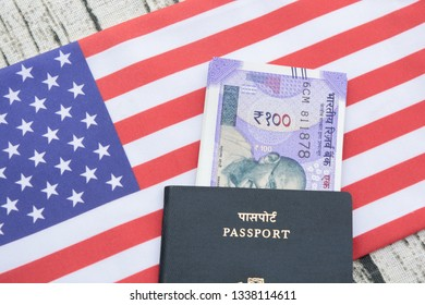 Closeup of Indian passport with currency on USA or america's flag as a background