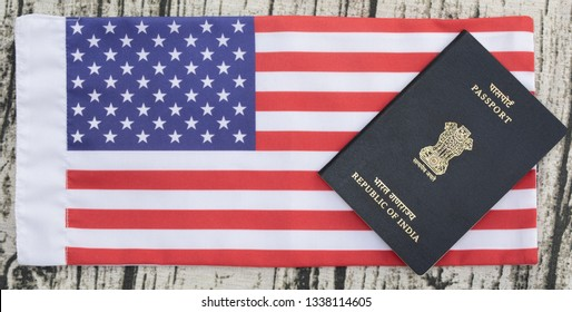 Closeup of Indian passport on USA or america's flag as a background