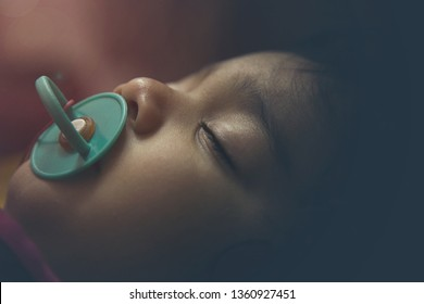 Closeup of an Indian toddler baby sleeping. Closeup of an Asian Indian Infant baby sleeping
