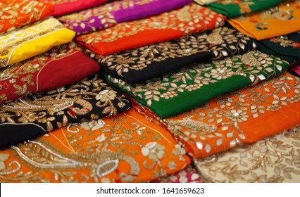 Closeup of Indian woman Salwar Kameez dress material stacked display in a retail shop