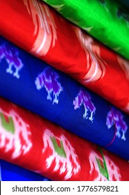 Close-up of Indian woman traditional dress saree or sari stacked in display in a retail store
