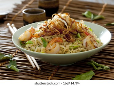 Closeup of Indonesian fried rice with vegetables, shrimp and fried shallots