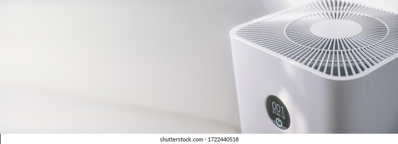 Closeup of an indoor Air purifier in the room is very safe and clean to breathe while dust air pollution situation outside is really bad. protect PM 2.5 dust and air pollution concept