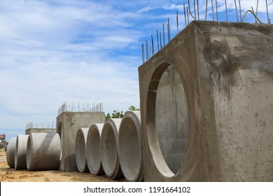Closeup of industrial concrete pipe for road building construction with blue sky bacground