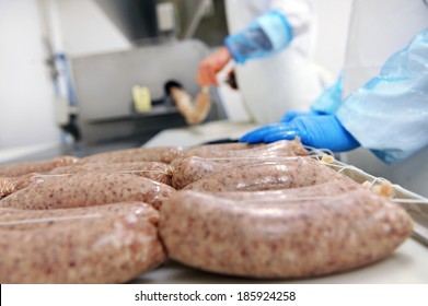 Close-up of industrial sausages production process in protective atmosphere