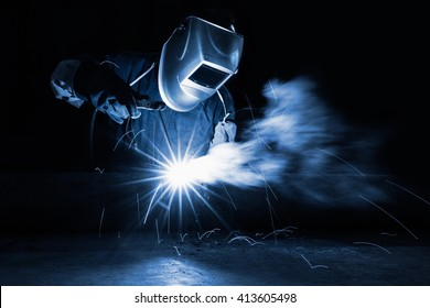 Closeup industrial Worker at the factory welding, Worker welding at industrial factory.