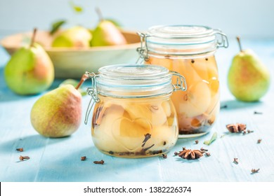 Closeup of ingredients for fresh pickled pears on blue table