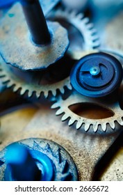 Closeup of the inner workings of a clock. Focus on the gear teeth.