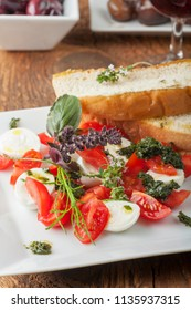 closeup of an insalada caprese with herbs