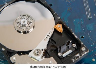 Closeup  inside Hard Drive on motherboard computer hardware