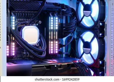 Close-up and inside high performance Desktop PC and Cooling system on CPU socket with multicolored LED RGB light show status on working, interior on Computer PC Case and DIY, technology background