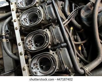 Closeup inside machine room carburetor on big bike sport motorcycle