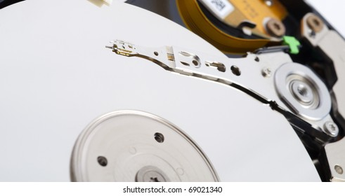 Close-up inside view of hard disk isolated on white background