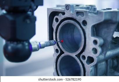 Closeup inspection dimension aluminum automotive parts by CMM in laboratory, measure, Measurement Tool, quality assurance, production, precision, qc concept.