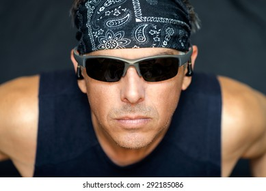 Close-up of intense athletic man looking to camera.