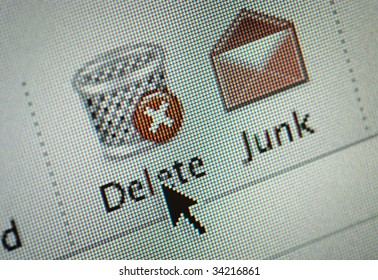Close-up of a interface computer delete and junk mail buttons and an arrow cursor