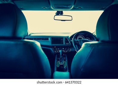 Closeup interior modern car console with full windscreen show space of front seat and passenger cabin , gear box , steering wheel and whole of dashboard function.