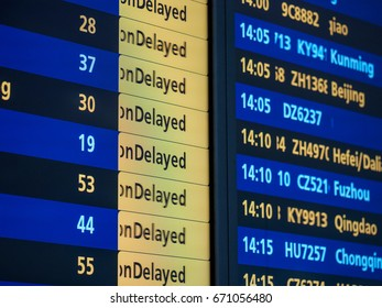 Close-Up of an international airport board panel with delayed.