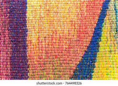 Closeup interweaving of colorful threads of tapestry. Selective focus