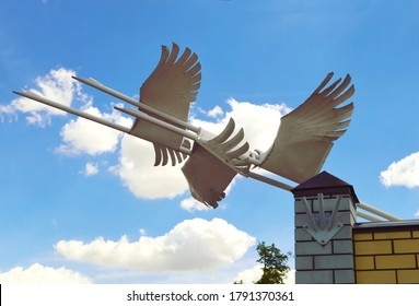 close-up - an iron sculpture from a group of white swans flying into the sky