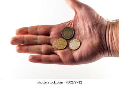 Closeup of isolated big hand with euro coins