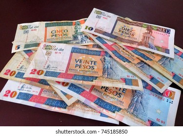 Close-up of isolated multiple bank notes / bills of Cuban convertible peso – national currency of Cuba designed to be used by tourists – local people use standard Cuban pesos