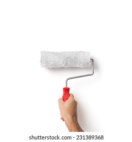 Closeup Of Isolated Painter's Hand Holding Roller Over White Wall