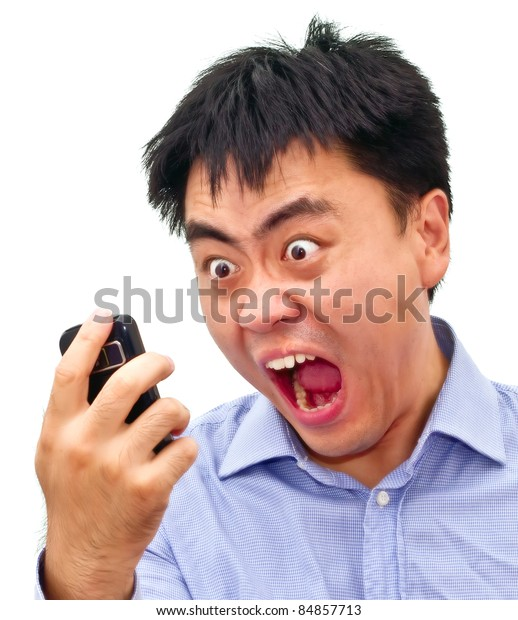 Closeup isolation photo of a crazy angry asian man yelling at his cellphone