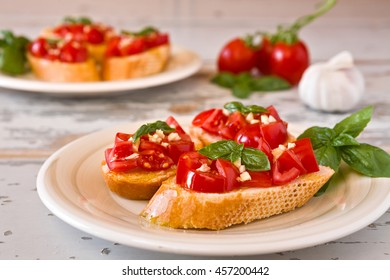 Closeup of Italian bruschetta with tomato, basil and garlic on a plate