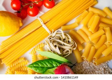 close-up italian food ingredients - pasta, rice, tomatoes