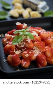 Closeup of italian gnocchi with strained tomatoes and grated parmesan, selective focus