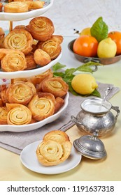 Closeup of Italian pinwheel orange pastries, typical sweets made during the carnival period from fried puff pastry flavored with orange zest and honey.