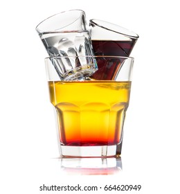 close-up Jager bull cocktail in glass, near a shot with white and a shot with brown luqiid isolated on white background
